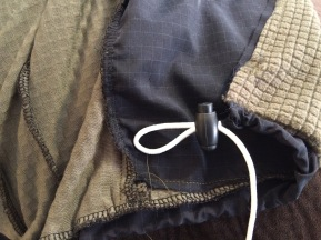 Corded elastic stopper
